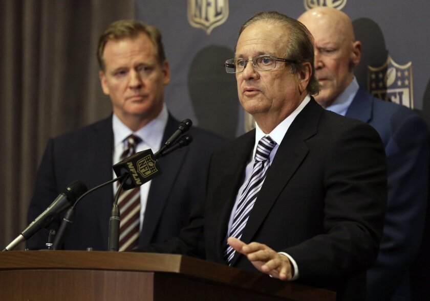 San Diego Chargers owner Dean Spanos, center, talks to the media as NFL Commissioner Roger Goodell looks on after team owners voted in 2016 to allow the Chargers to move to L.A.