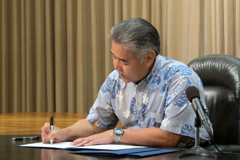 Hawaii Gov. David Ige signs bills Tuesday in Honolulu, including two on medical marijuana.