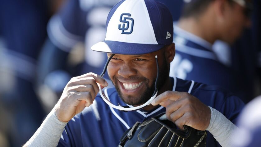 Padres' Manuel Margot walks in the dugout during the first inning of a spring training baseball game against the Texas Rangers, Thursday, March 1, 2018, in Surprise, Ariz.