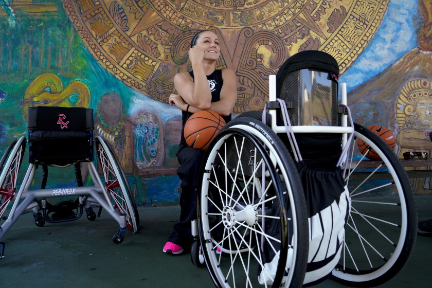 Wheelchair basketball Paralympian Megan Blunk, 30, pauses during a practice session Tuesday, Oct. 8, on the basketball court at Chicano Park in San Diego.