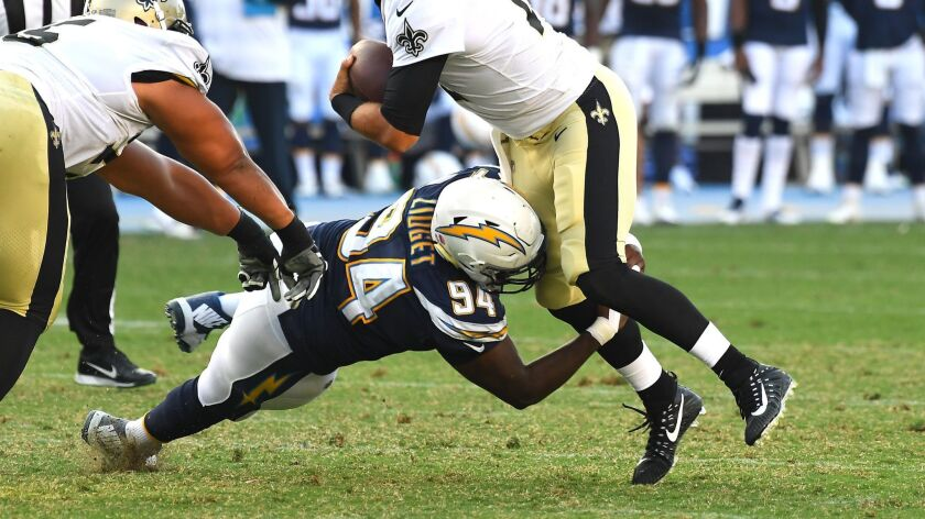 Corey Liuget sacks Saints quarterback Tom Savage in a preseason game.