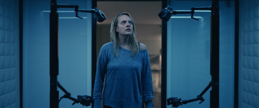 """This image released by Universal Pictures shows Elisabeth Moss in a scene from """"The Invisible Man."""" (Universal Pictures via AP)"""