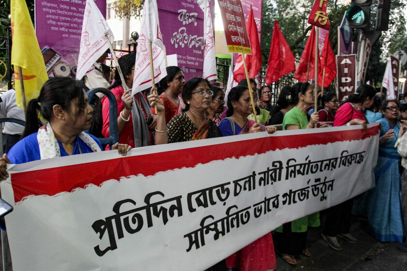 "Activists demanding justice in the case of a veterinarian who was gang-raped and killed last week shout slogans during a protest in Kolkata, India, Thursday, Dec. 5, 2019. According to the most recent available official crime records, police registered 33,658 cases of rape in India in 2017 - an average of more than 90 every day. But the real figure is believed to be far higher as many women in India don't report cases to police due to fear. Banner reads, ""Protest against regular incidents of violence on women"". (AP Photo/Bikas Das)"