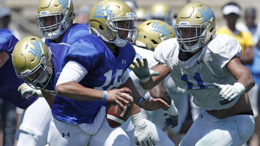 LOS ANGELES, CALIF. - APR. 21, 2018. UCLA quarterback Devon Modster gets pressured by defensive bac
