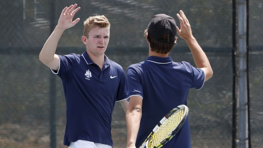 Newport Harbor High boys' tennis doubles team of Josh Watkins, left, and Andy Myers, right, react af