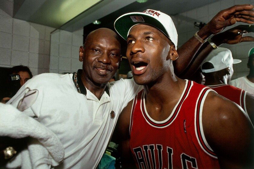 Michael Jordan of the Chicago Bulls celebrates winning the NBA Championship with his father after Game 6 of the NBA Finals on June 20, 1993 at t,he America West Arena in Phoenix.