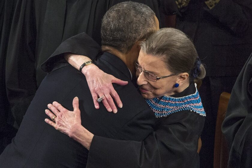 The late Supreme Court Justice Ruth Bader Ginsburg embraces President Obama after his 2014 State of the Union.