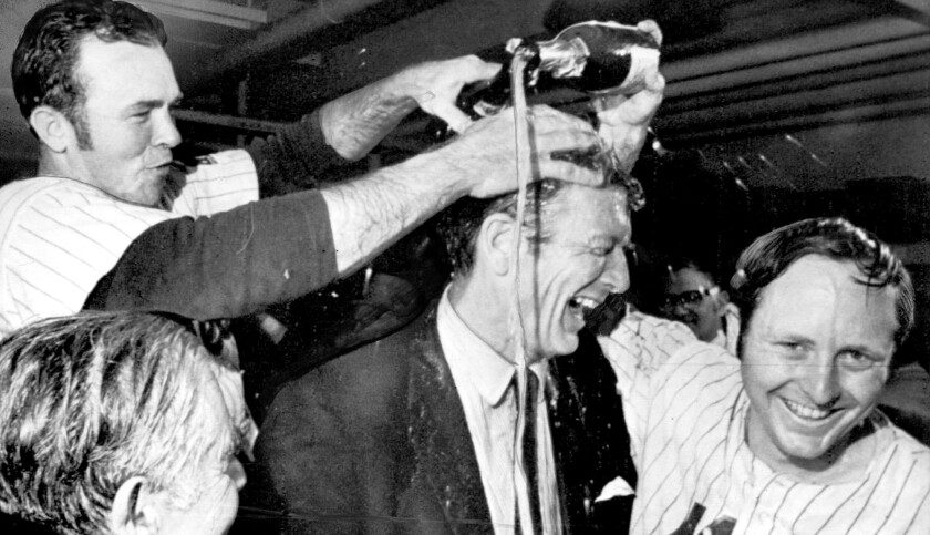 The Mets' Rod Gaspar, right, and Jerry Grote give New York Mayor John Lindsay a champagne shower after clinching the NL pennant in 1969.