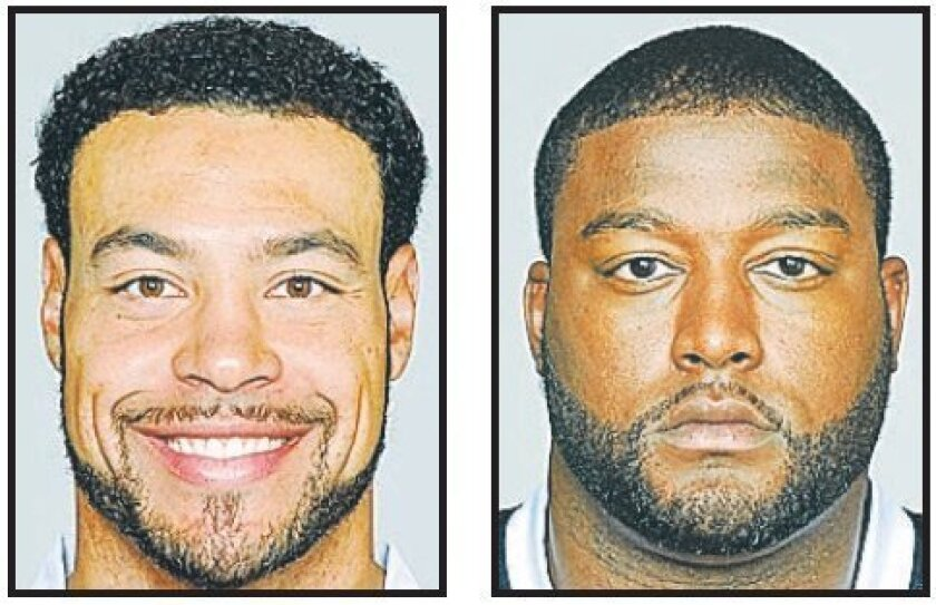 Wide receiver Vincent Jackson (left) and left tackle Marcus McNeill are in a salary standoff with the Chargers.