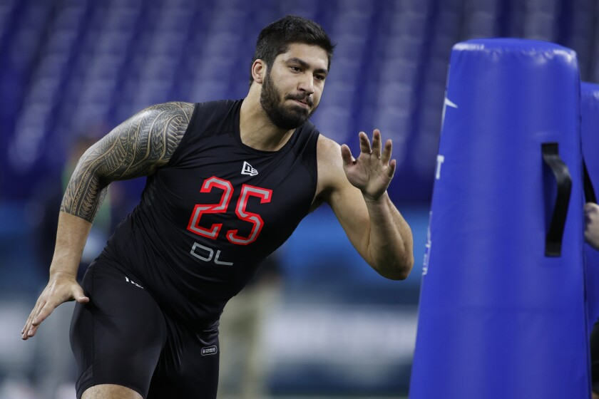 Defensive lineman A.J. Epenesa of Iowa runs a drill during the NFL combine