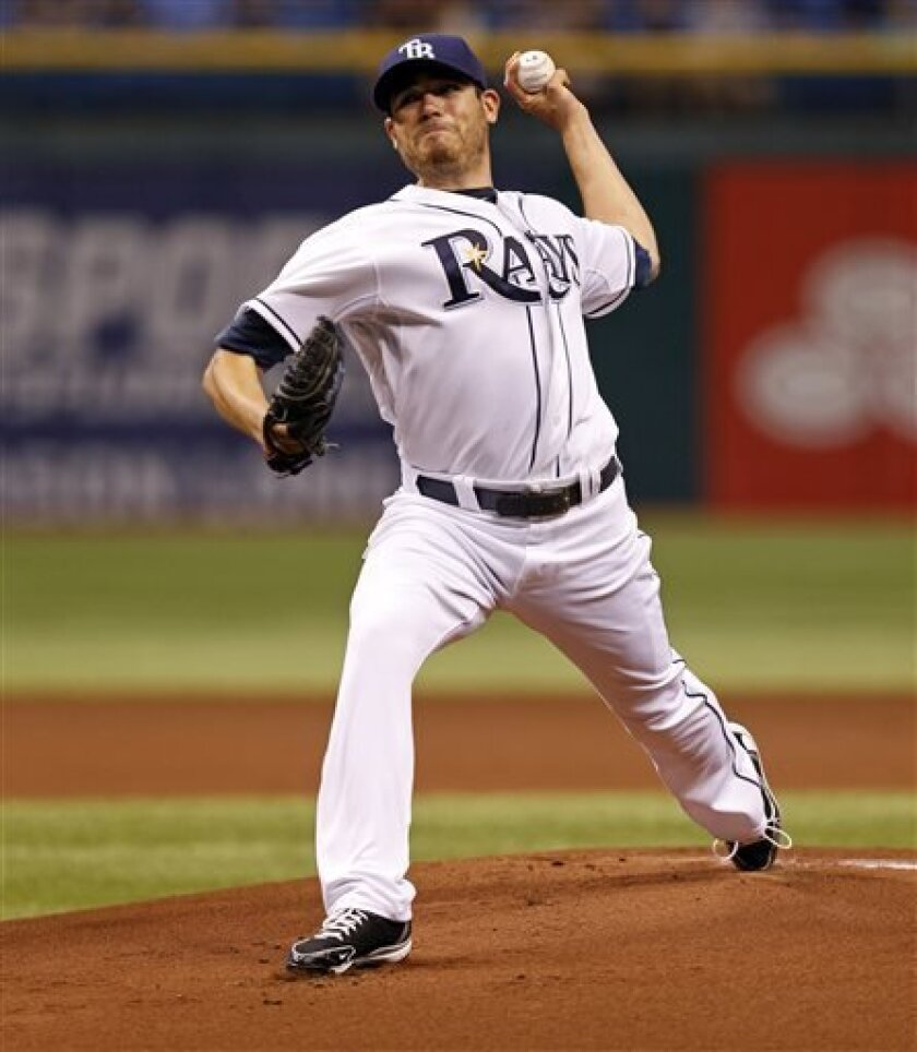 Tampa Bay Rays starting pitcher Matt Moore throws during the first inning of a baseball game against the Cleveland Indians, Friday, April 5, 2013, in St. Petersburg, Fla. (AP Photo/Mike Carlson)