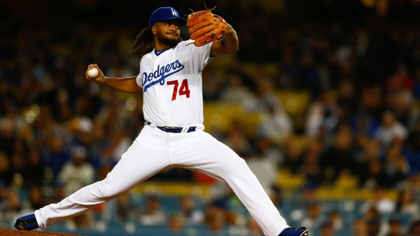 Dodgers relief pitcher Kenley Jansen pitches against the San Francisco Giants during the ninth inning at Dodger Stadium on Tuesday.