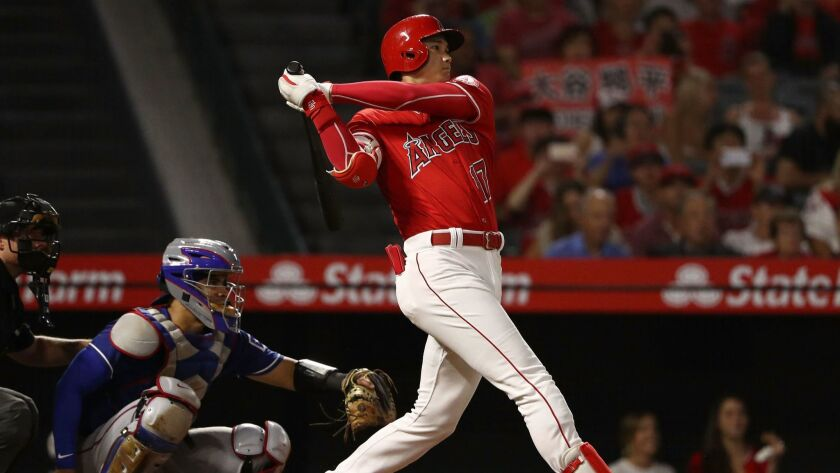 Angels' Shohei Ohtani hits a double in the fourth inning.