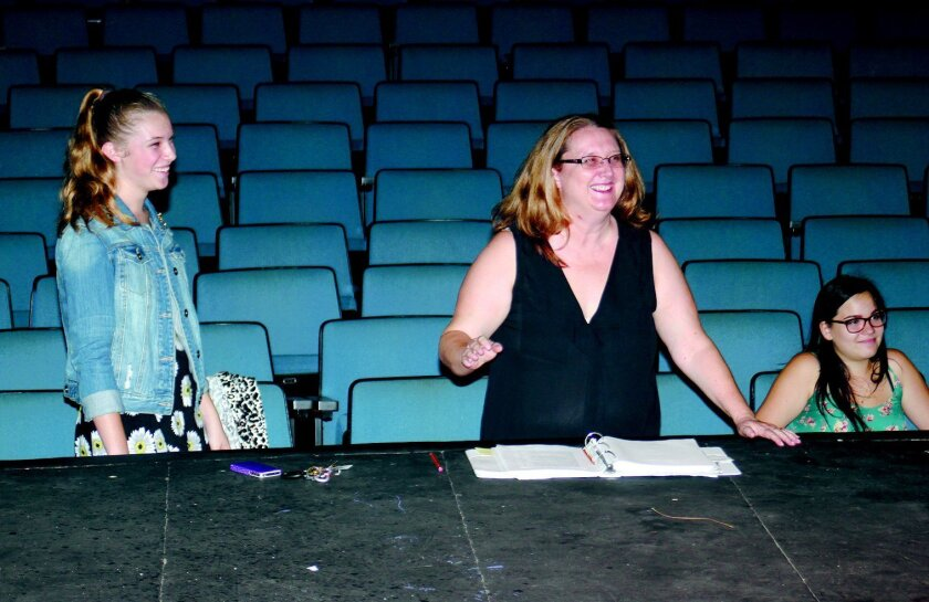 Marjorie Treger, the new head of La Jolla High's theater department, directs a scene from the school's upcoming production of 'Almost, Maine.' At left is daughter Jamison Treger.