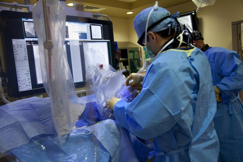 Dr. Ryan Reeves and Dr. John Bahadorani perform a stenting procedure in 2014 at Sulpizio Cardiovascular Center in La Jolla.