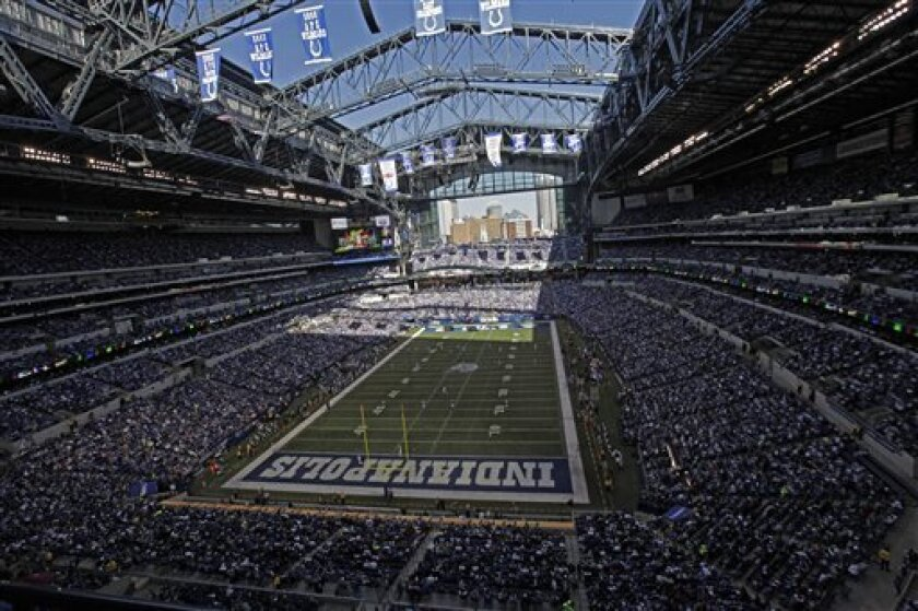In this Sunday, Nov. 6, 2011 file photo, fans sit packed into Lucas Oil Stadium during the first half of an NFL football game between the Indianapolis Colts and the Atlanta Falcons in Indianapolis.  (AP Photo/AJ Mast, File)