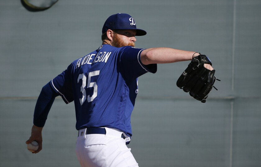 Dodgers southpaw Brett Anderson pitches during a spring training workout on Feb. 22.