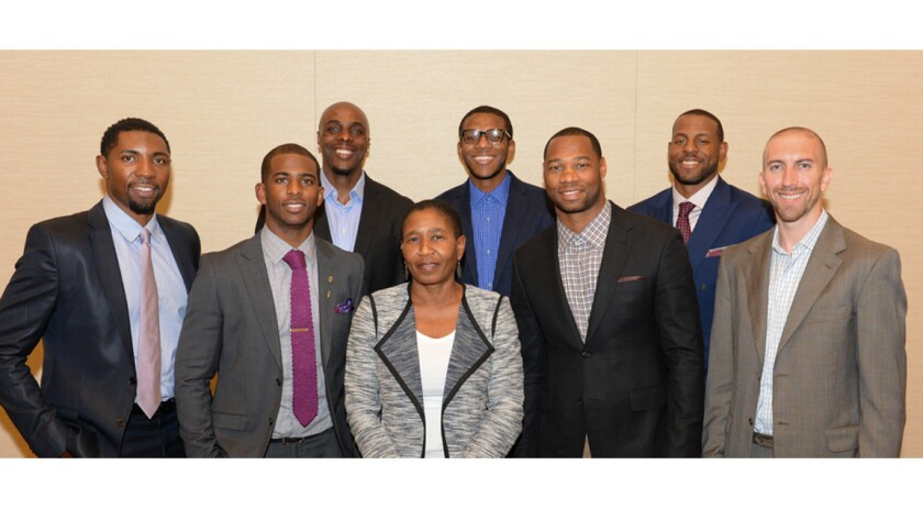 Michele Roberts, center, the new executive director for the National Basketball Players' Assn., stands with the union's executive committee (from left): Roger Mason, Chris Paul, Anthony Tolliver, James Jones, Willie Green, Andre Iguodala and Steve Blake.