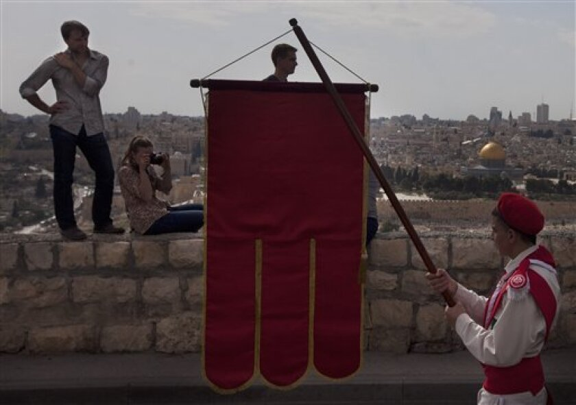Christian pilgrims participate in the traditional Palm Sunday procession on the Mount of Olives, overlooking Jerusalem's Old City, Sunday, April 1, 2012. Palm Sunday marks for Christians, Jesus Christ's entrance into Jerusalem, when his followers laid palm branches in his path, prior to his crucifi