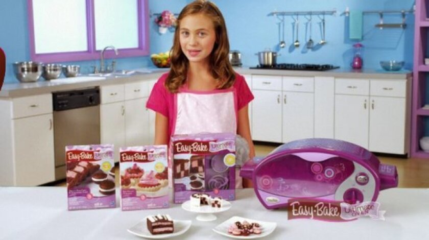 In this screen shot of an Easy-Bake promotional video, the oven is shown in its purple and pink design.