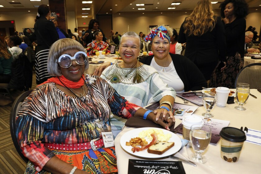 From left to right, activist Kathleen Harmon, author Starla Lewis and Marian Penick gathered to celebrate black women leaders during the 3rd Annual Women of Color ROAR breakfast Saturday at the  Jacobs Center for Neighborhood Innovation.
