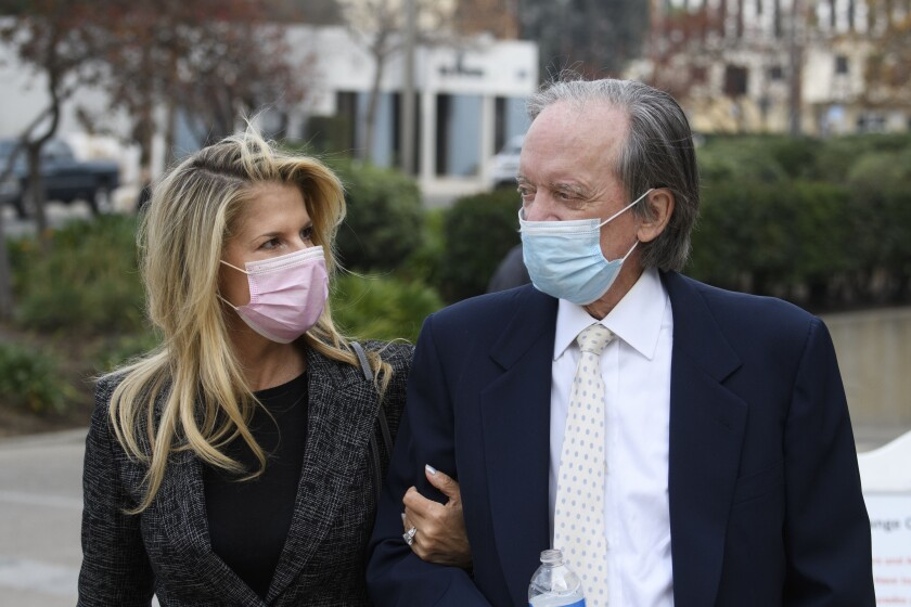 Bill Gross and partner Amy Schwartz arrive for a court hearing Dec. 7 in Santa Ana.