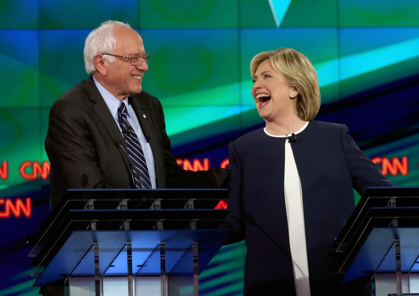 Democratic presidential candidates Bernie Sanders and Hillary Clinton take part in a televised debate in Las Vegas on Oct. 13.