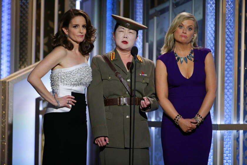 Tina Fey, left, Margaret Cho (playing a new HFPA member and North Korean general) and Amy Poehler perform at the Golden Globe Awards.