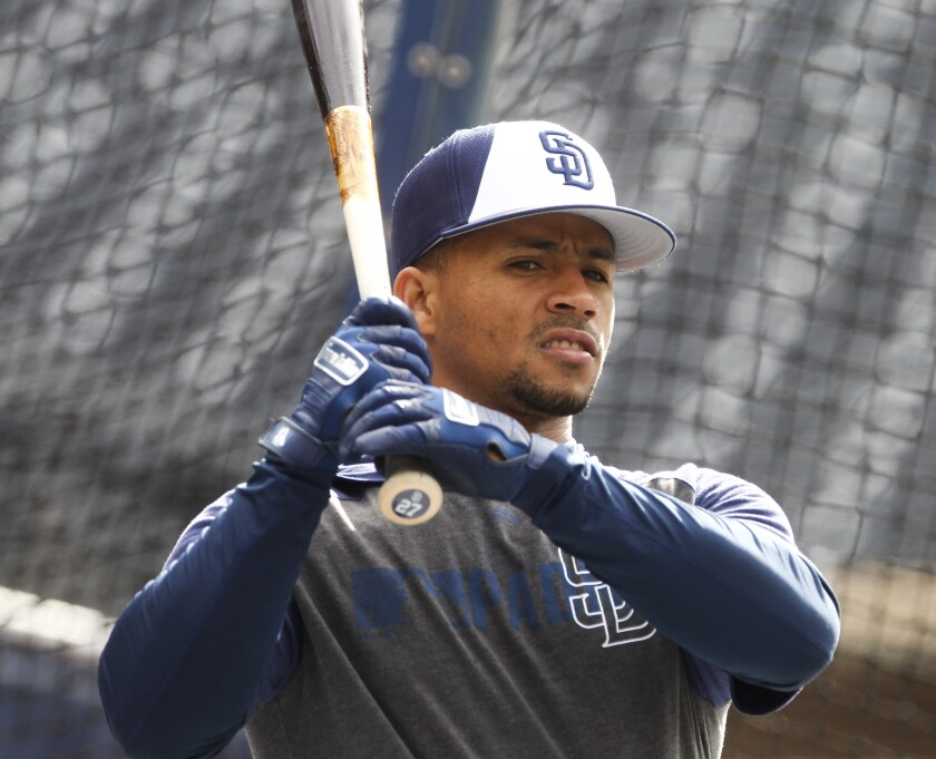 Padres catcher Francisco Mejia warms up during batting practice before the Padres play the Mets on May 7.