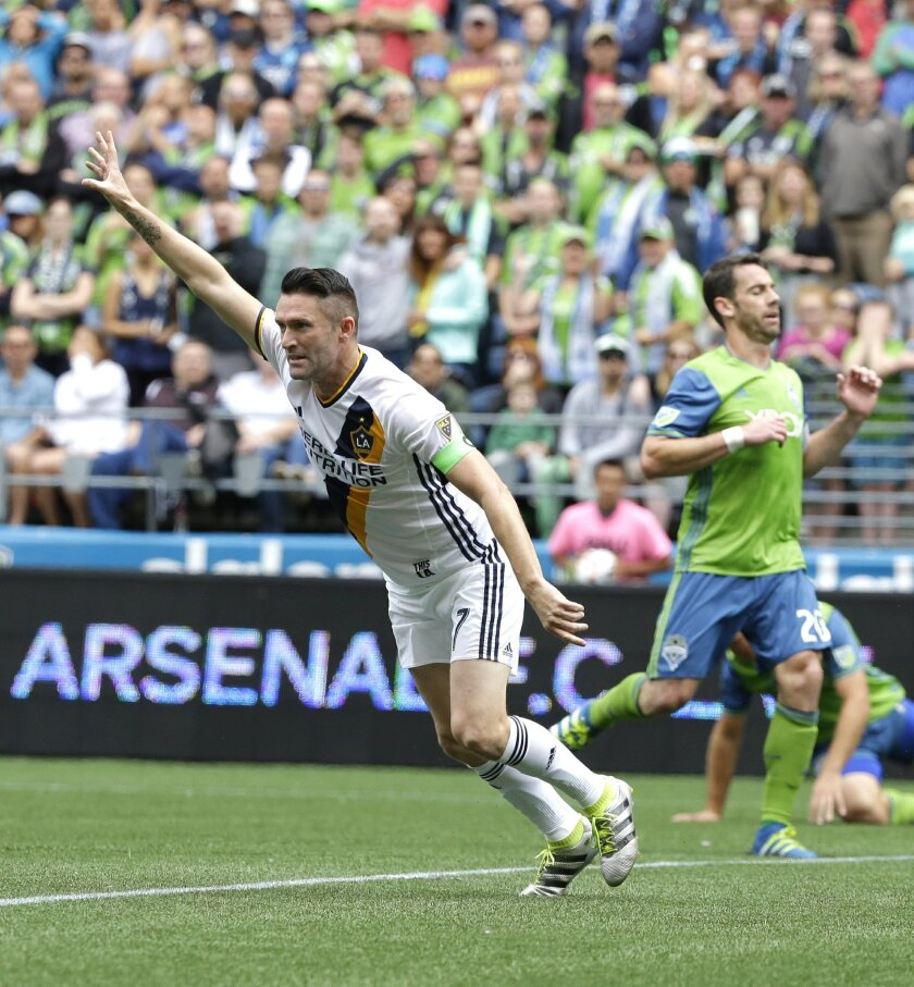 Los Angeles Galaxy forward Robbie Keane, left, celebrates after he scored a goal against the Seattle Sounders in the first half of an MLS soccer match, Saturday, July 9, 2016 in Seattle. (AP Photo/Ted S. Warren)