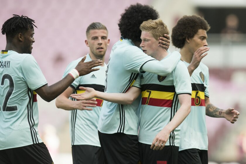 Belgian Kevin De Bruyne, second right, celebrates with team mates after scoring during a friendly soccer match between Switzerland and Belgium, at the stade de Geneve stadium, in Geneva, Switzerland, Saturday, May 28, 2016. (Jean-Christophe Bott/Keystone via AP)
