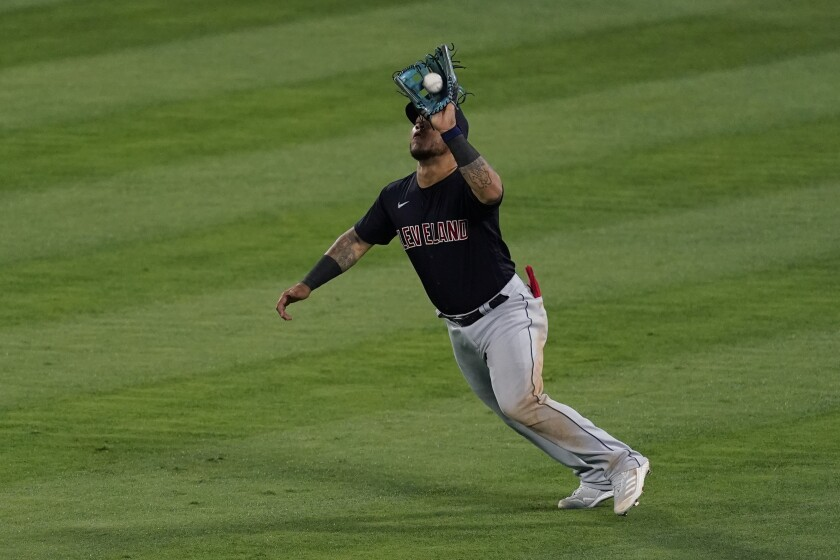 Cleveland Indians center fielder Harold Ramirez (40) catches a fly ball hit by Los Angeles Angels' Taylor Ward during the fifth inning of a baseball game Tuesday, May 18, 2021, in Anaheim, Calif. (AP Photo/Ashley Landis)