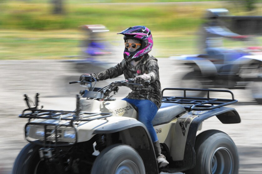 Taylee Barnes drives an all-terrain vehicle in Ogden, Utah, a city that's recovered quicker than most from the recession.