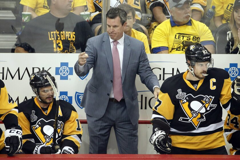 Pittsburgh Penguins coach Mike Sullivan gives instructions during the first period in Game 2 of the NHL hockey Stanley Cup Finals against the San Jose Sharks on Wednesday, June 1, 2016, in Pittsburgh. (AP Photo/Gene J. Puskar)