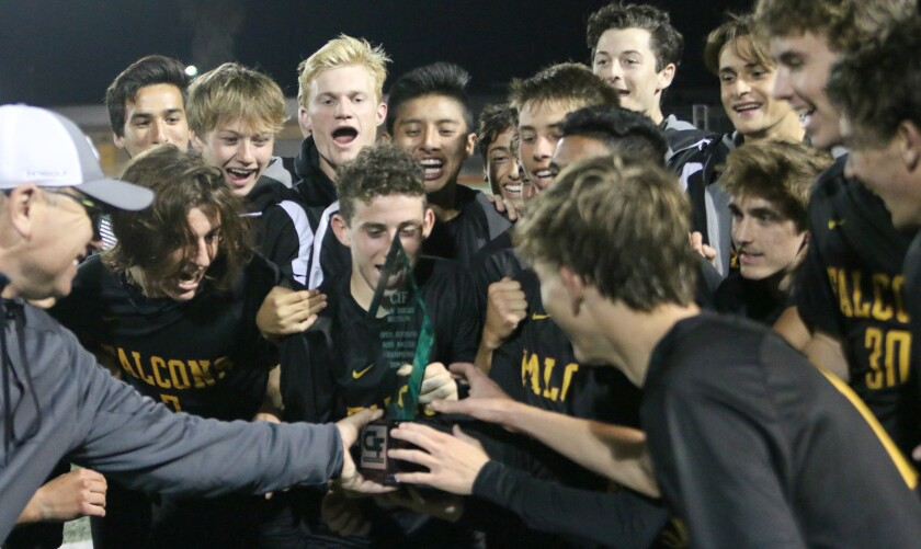 Coach Andy Hargreaves shares the CIF trophy.
