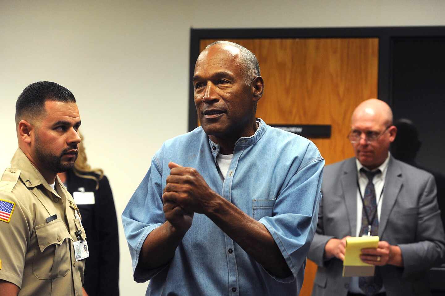 O.J. Simpson reacts after learning he was granted parole at Lovelock Correctional Center in Lovelock, Nevada.