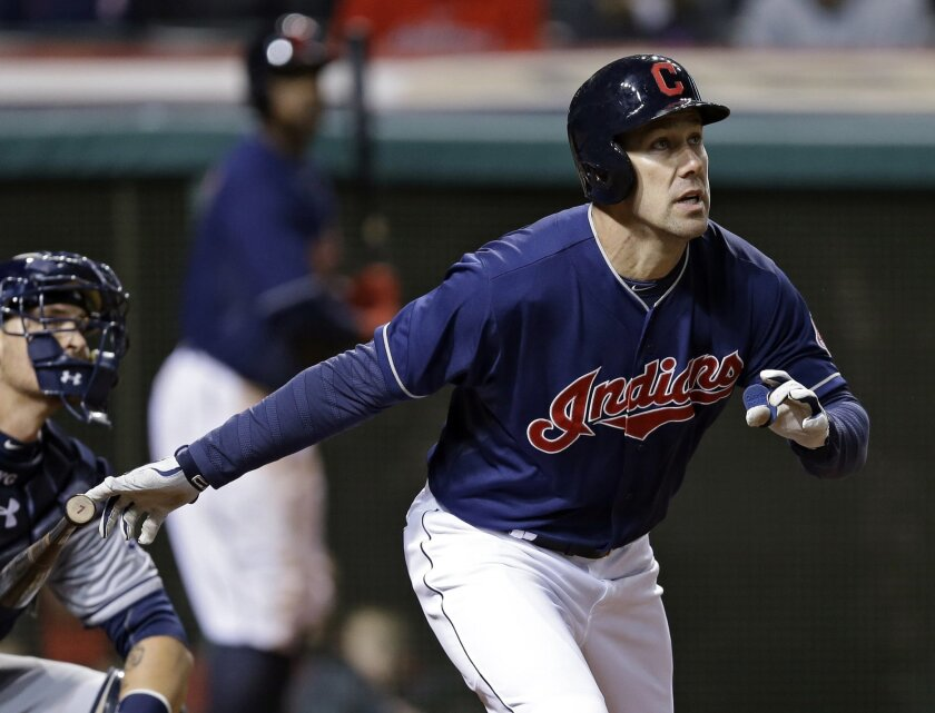The Indians' David Murphy watches his three-run home run off San Diego Padres starting pitcher Tyson Ross in the fourth inning of the MLB baseball game Tuesday, April 8, 2014, in Cleveland.