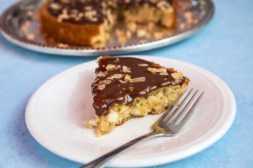 Chewy coconut cake with milk chocolate glaze