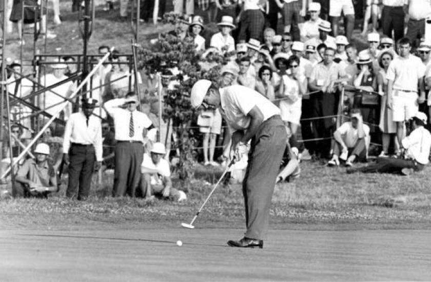 Ken Venturi sinks his final putt to win the 1964 U.S. Open at Congressional Country Club in Bethesda, Md. Venturi lay on the clubhouse floor between rounds suffering from dehydration and exhaustion. Playing slowly and taking water and salt pills, he overtook leader Tommy Jacobs about midway through the final round and finished with a 70 to win by four strokes.