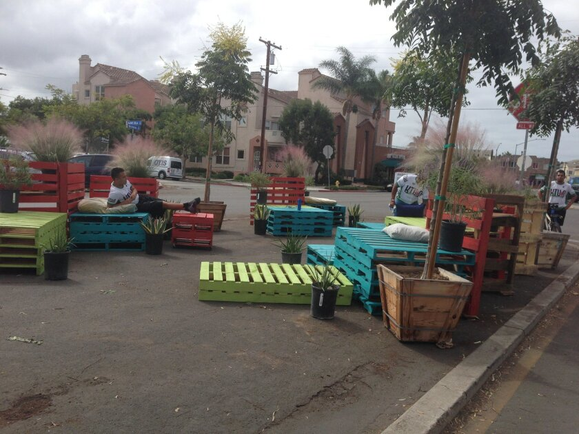 Part of the  median in Normal Street at Harvey Milk Way in Hillcrest was outfitted by KTU+A designers as a temporary park, using donated wooden palettes and borrowed plants.