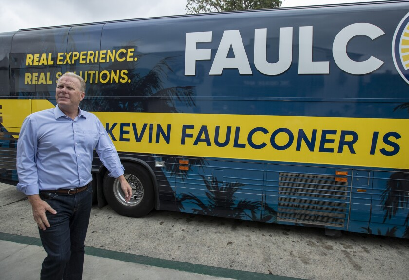 Former San Diego Mayor Kevin Faulconer walks back to his bus after a campaign stop in Whittier on Aug. 21.