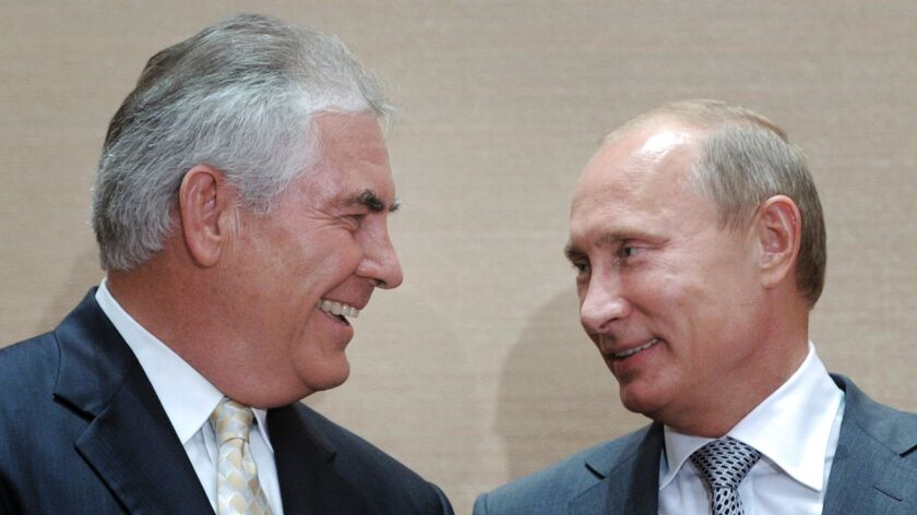 Russian Prime Minister Vladimir Putin, right, and Exxon Mobil chief executive Rex Tillerson in Sochi, Russia on Aug. 30, 2011.