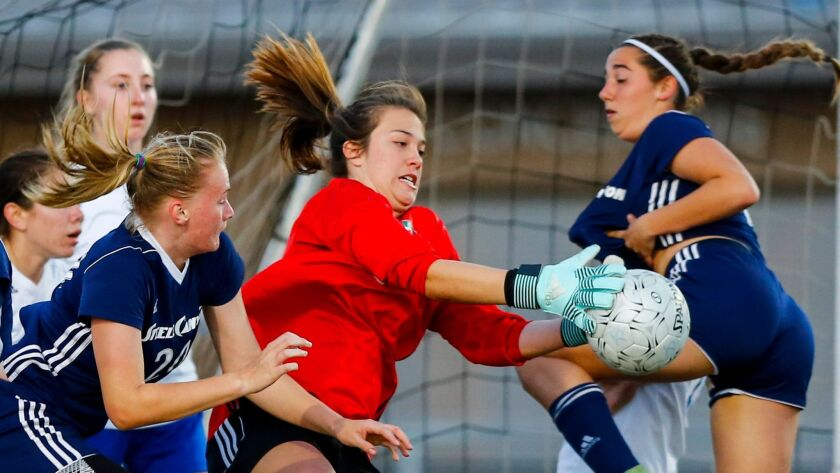 Eastlake goalie Gloriana Hinajosa makes a stop in the first half on a Steele Canyon corner kick.