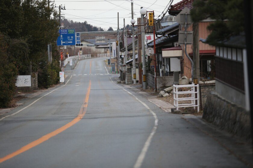 A deserted street inside the exclusion zone close near the Fukushima Daiichi Nuclear Power Plant.