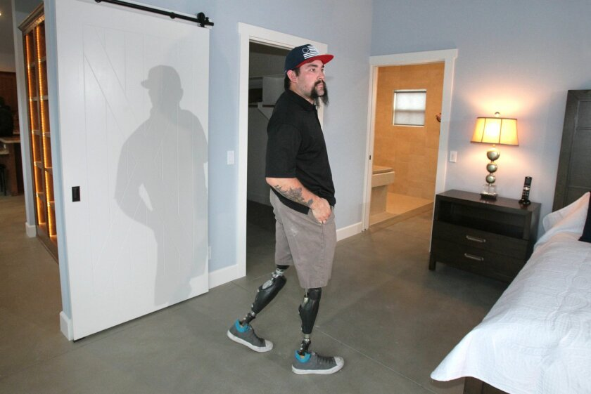 Nick Kimmel enters his bedroom for the first time in his new home.