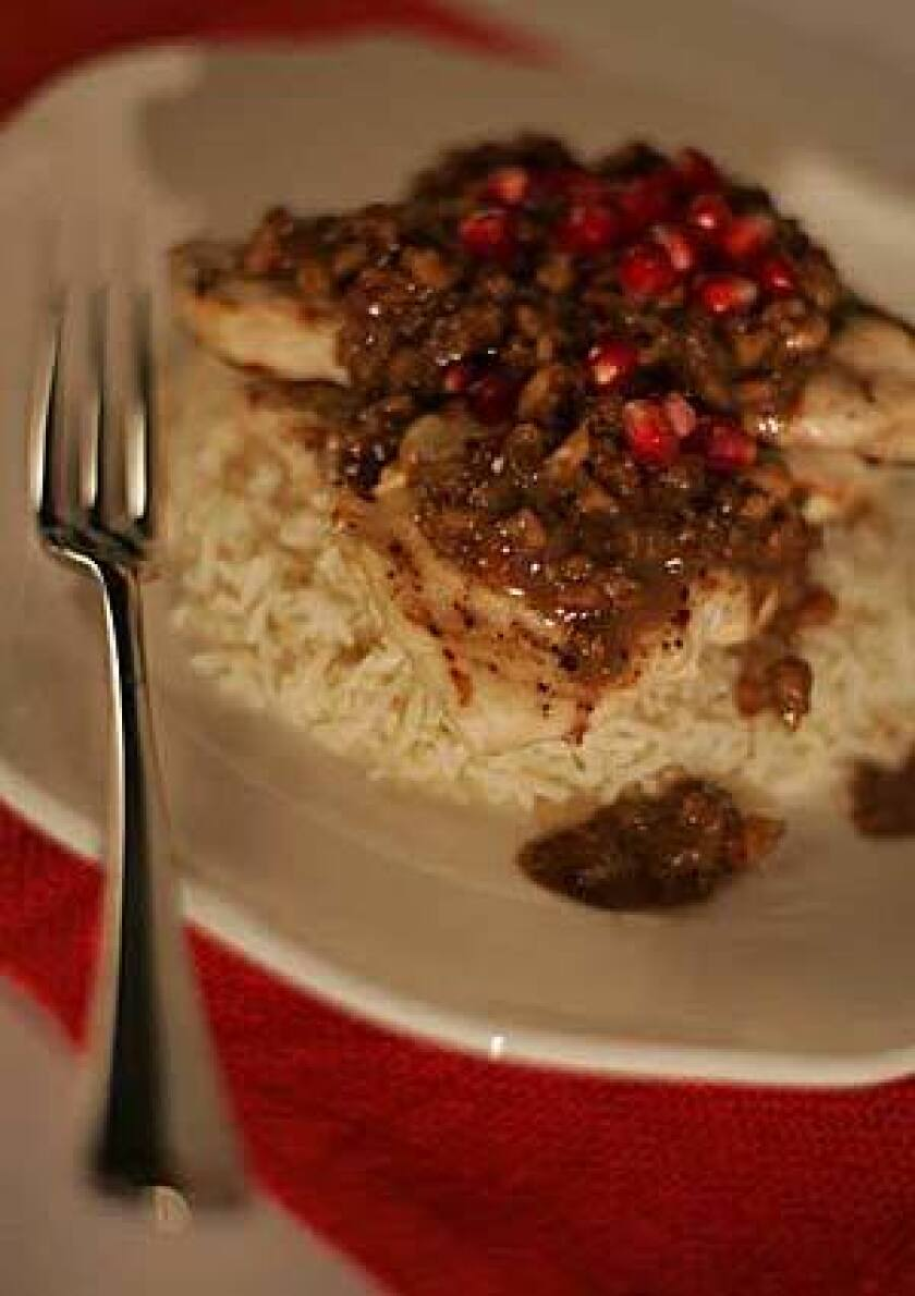 Add some color to your chicken dish with some pomegranate. Recipe: Cayenne Cafe chicken with pomegranate
