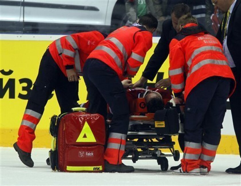 Czech Republic's Radek Martinek is removed from the ice during the preliminary round group D match of the World Hockey Championships at the ice hockey Ondrej Nepela stadium in Bratislava, Slovakia, on Saturday, April 30, 2011. (AP Photo/Ronald Zak)