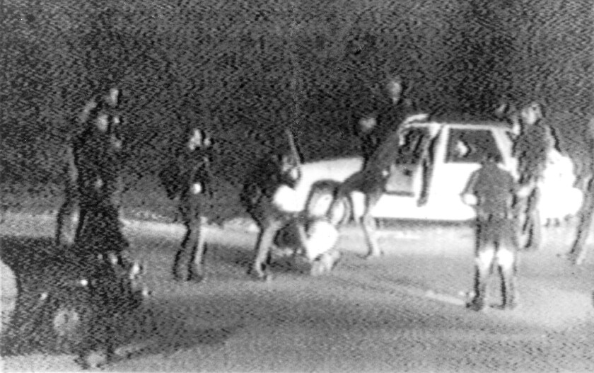 A still image taken from George Holliday's 1991 video shows police officers beating a man, later identified as Rodney King.