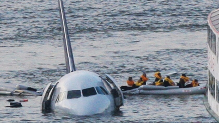 A raft leaves the US Airways jet that landed on the Hudson River in New York on Jan. 15, 2009. American Airlines helped Clint Eastwood film his movie on the crash and its aftermath, but won't show it on flights.