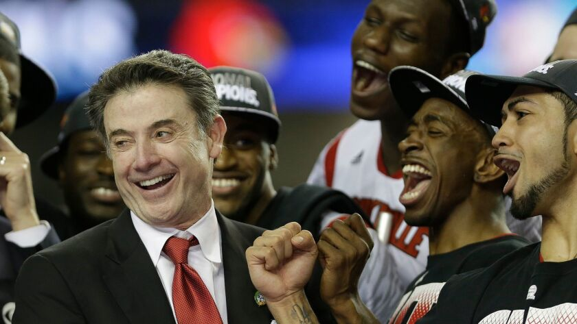 FILE - In this April 8, 2013, file photo, Louisville head coach Rick Pitino reacts with his team aft